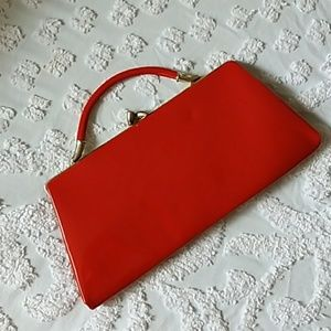 Red vintage clutch w/ hidable handle